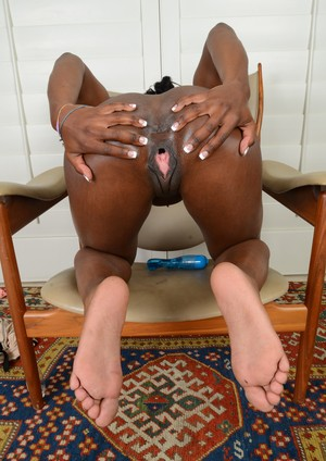 Black MILF Ana Foxxx shoves a blue vibrator in snatch and flashes white feet