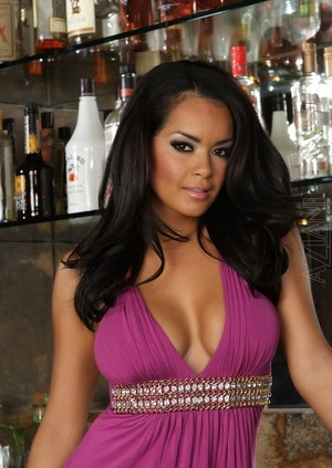 Buxom Latina Daisy Marie takes off violet dress exposing pussy in pub