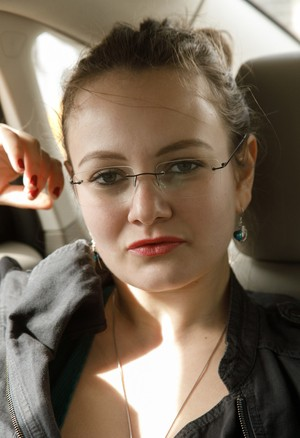 Eccentric chick with jugs Shelley Fox sits in backseat dressed in pantyhose
