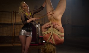 Harsh domme Cherry Torn whips gagged male sub in rough inverted suspension