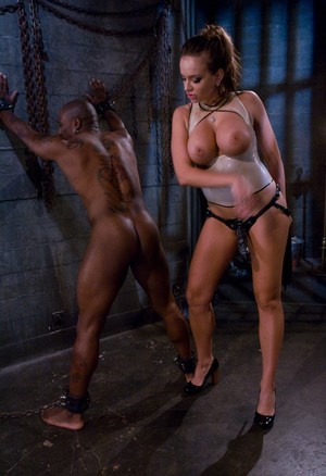 Busty mistress Nika Noire in latex flogging her ebony sub & pegging his ass
