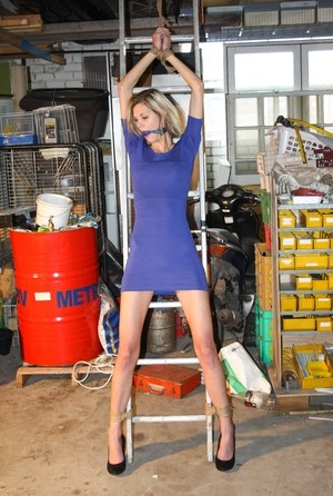 Amateur blonde Irena gagged  tied fully clothed to a ladder for garage grope