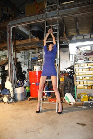 Amateur blonde Irena gagged & tied fully clothed to a ladder for garage grope