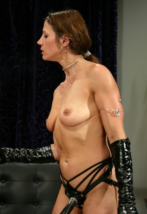 Latex clad dominatrix Kym Wilde trains blindfolded male sub with crop