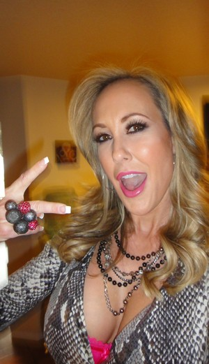 Happy MILF Brandi Love flashing hot ass & big tits preparing for porn shoot
