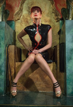Demanding dominatrix Maitresse Madeline Marlowe posing in latex with her whip