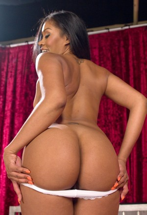 Gorgeous ebony strips to bare her hot booty to her black clad lezdom mistress