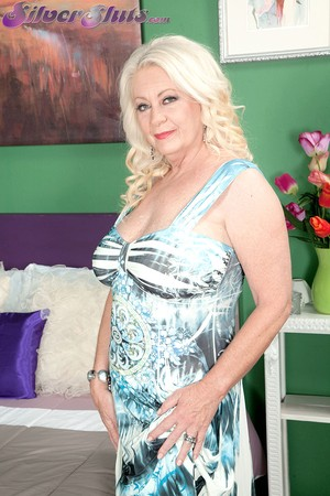 Mature blonde fatty Angelique DuBois reveals big saggy tits to give stud head