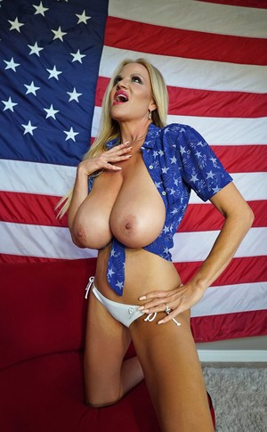 Patriotic MILF Kelly Madison supports her country with massive big tits bare