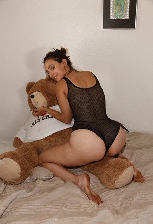 Coy young girlfriend Rhonda Biasi in sheer bodysuit flaunting shapely ass