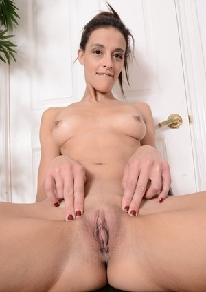 Skinny mature Taylor Foxx disrobes to expose her thin body & spread ass