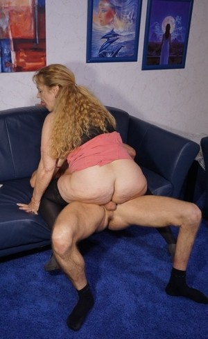 Horny older wife frees saggy big tits  rides sweaty stud cowgirl style
