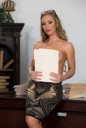 Hottest blonde pornstar in the world Nicole Aniston posing on her office desk