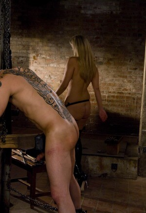 Dominant blonde Jordan Kingsley fucks chained guys ass with strapon