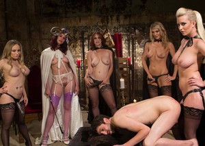 A bevy of femdom bitches torment a male sub with whipping CBT  rough sex