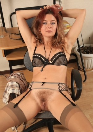 Hairy mature redhead Helen Volga spreads proving the carpet matches the drapes