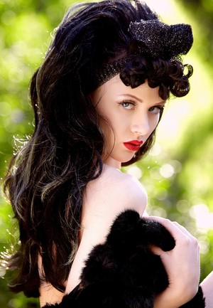 Pale black haired Mosh pose erotically with her boa naked among the trees