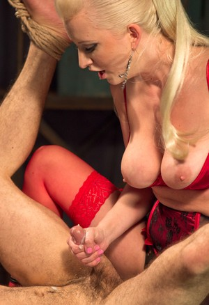 Wicked blonde dominatrix Cherry Torn pegging her bound sub  jerking his cock