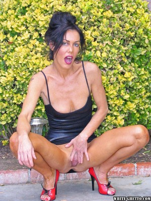 Scary looking Nancy Vee spreads pussy on patio before raunchy pussy to mouth