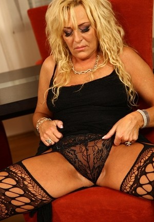 Mature blonde Andrea flashes sheer panty upskirt & fingers in extreme closeup