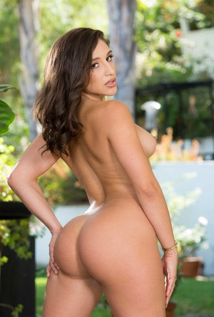 Super sexy brunette Abella Danger poses delectable naked body on the patio