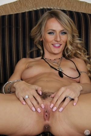 Gorgeous blonde Natasha Starr spreads her slender long legs to show nice pussy