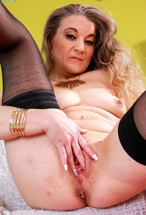 Horny older mature Valerie Mack unveils her nice body for hot solo fingering