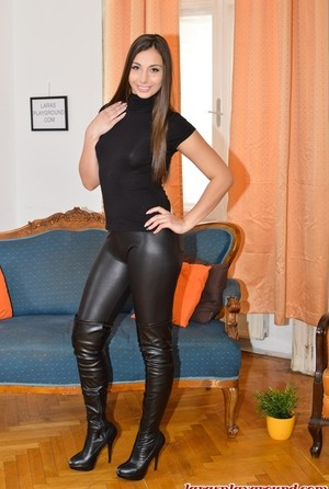 Hot Carla Crouz takes off T-shirt and tight leather pants and boots