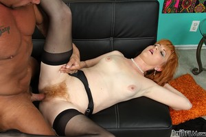 Flaming redhead Sasha Brand uncovers small natural tits for hairy pussy fuck