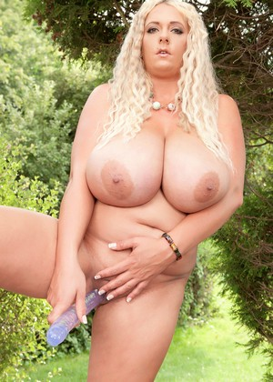 Striking blonde Emilia Boshe uncovers her enormous big tits to toy outdoors