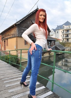 Tattooed provocative redhead undresses and exhibits her small tits and hot but