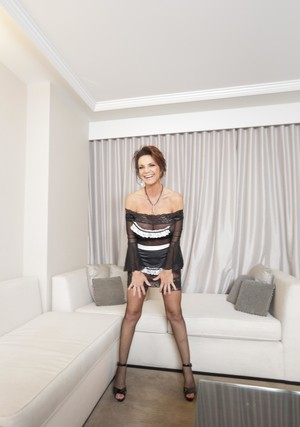 Busty maid Deauxma fondles her enhanced big tits while ...