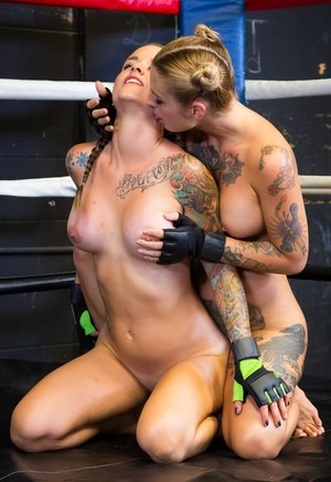 Slender lesbian boxing babes get naked for hot pussy licking in the ring