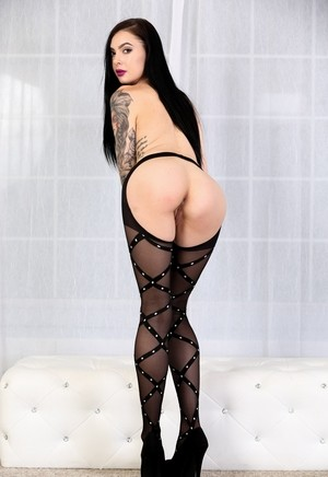 Stunning dark haired beauty Marley Brinx showing her tattoos and body