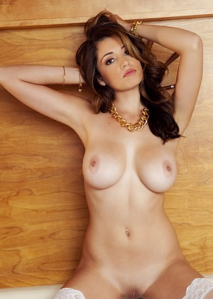 Brunette with big natural melons Ali Rose teasing with her curves on the bed