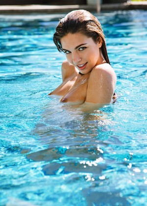 Tall brunette Jessica Ashley gets all wet and horny at the pool