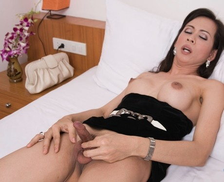Lonely shemale from Asia relaxes on bed and keeps jerking small dick 포르노 사진 #422173492